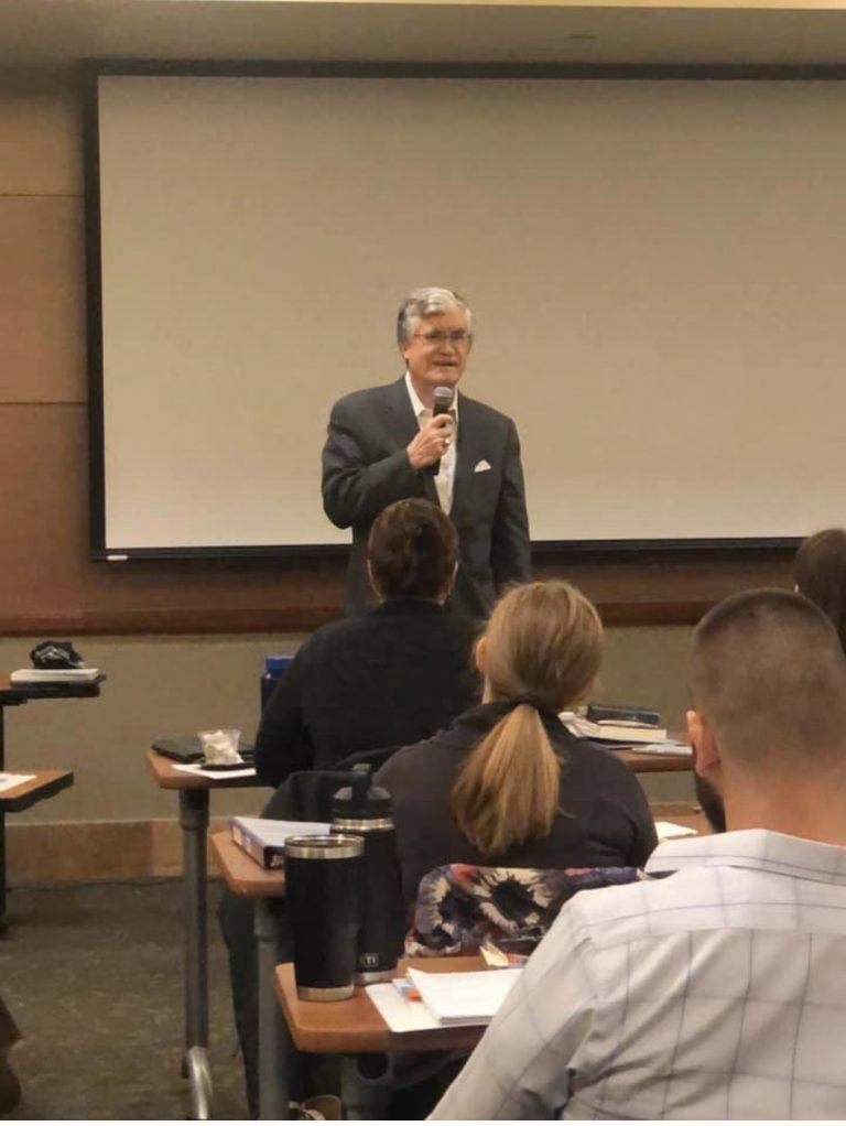 john broderick speaking to class
