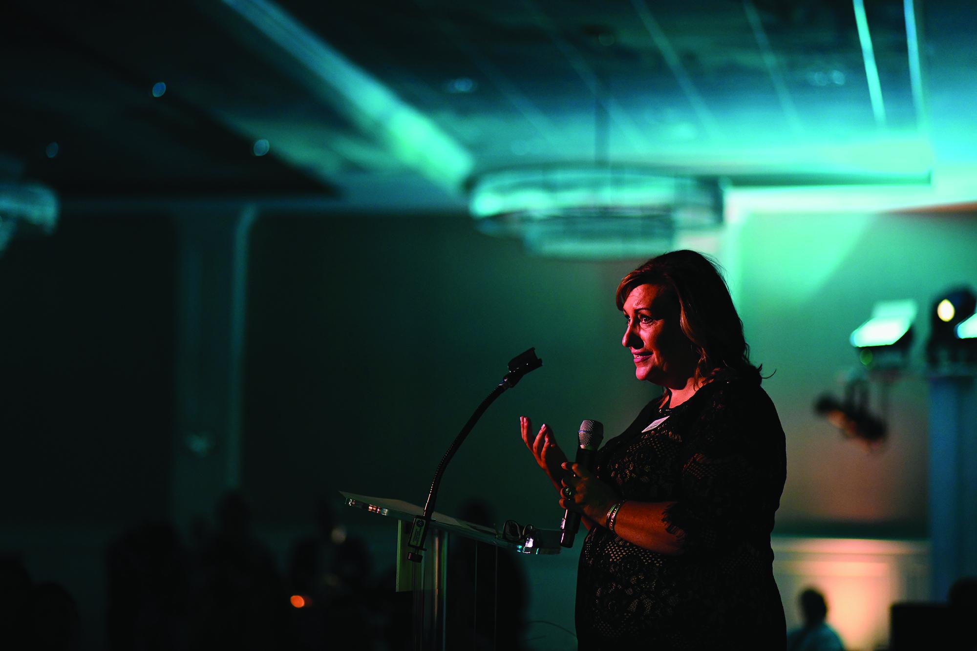 lori waltz gagnon speaking at event